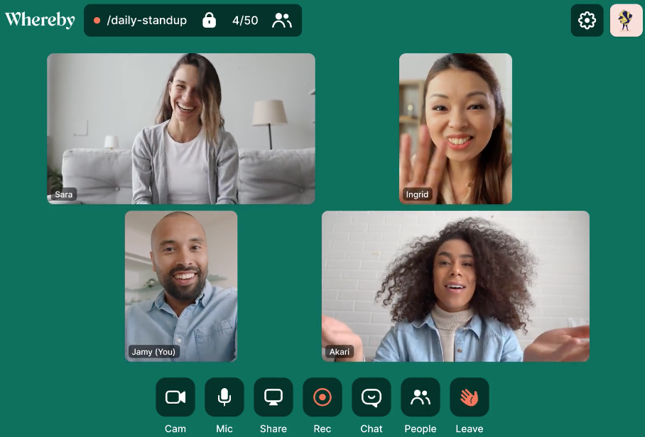 The Whereby video chat tool showing four speakers, as well as controls for chat and emoji.
